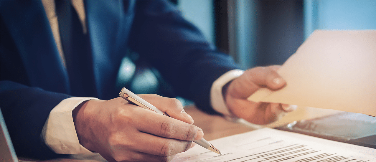 Man making notes to document